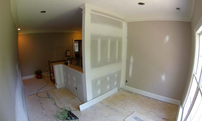 Before picture of a two-story foyer conversion which was part of a home remodel project designed to maximize useful home square-footage
