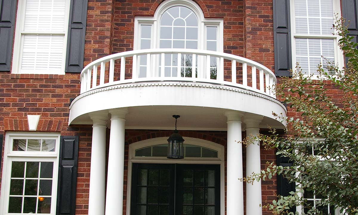 Newly repaired classically styled portico and top railing