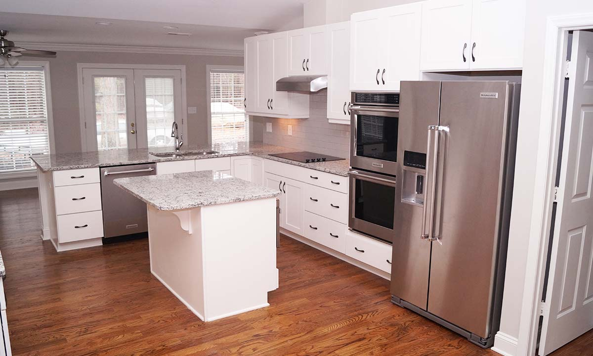 New kitchen features granite countertops, stainless steel appliances and a large island for workspace and seating